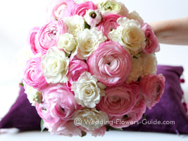 pink ranunculus in a bridal bouquet
