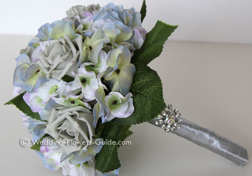 artificial wedding bouquet featuring hydrangeas and roses