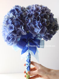 blue wedding bouquet made out of hydrangeas