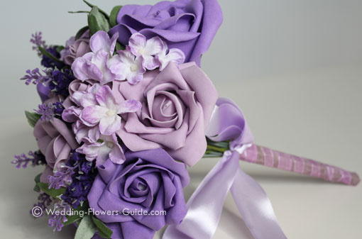 An artificial wedding bouquet in purple