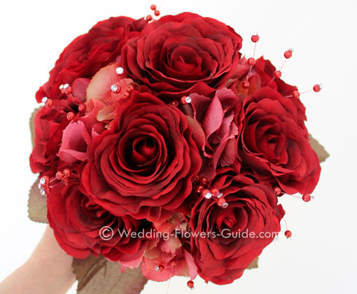 red wedding bouquet made from artificial flowers
