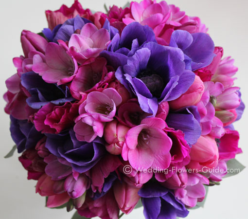 anenomes, tulips and freesias in a spring wedding bouquet