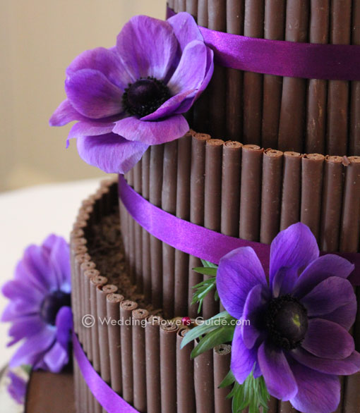 purple anenomes used to decorate a wedding cake
