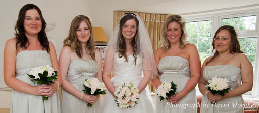 bride and her bridesmaids holding their wedding bouquets