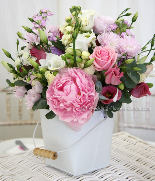 pink peonies used in a low wedding centerpiece for a spring wedding
