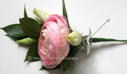 ranunculus made into a spring wedding buttonhole