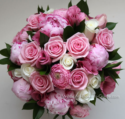pink ranunculus, roses and peonies in a handtied wedding bouquet