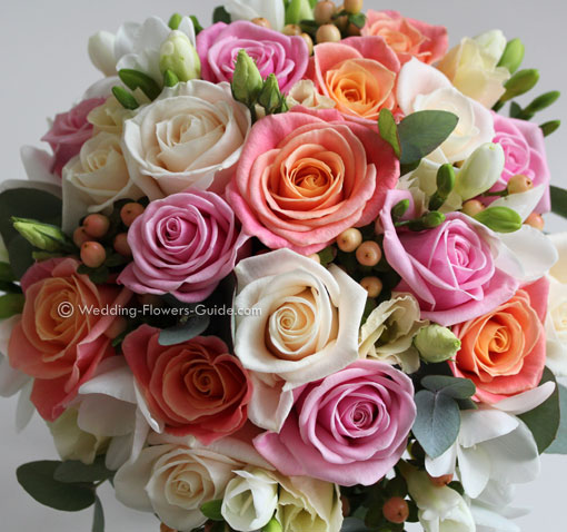 bridal bouquet featuring peach, cream and pale pink roses