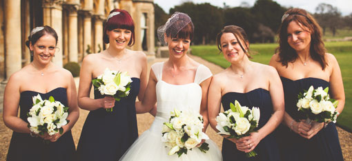 bride and bridesmaids holding vintage style wedding bouquets at Walton Hall
