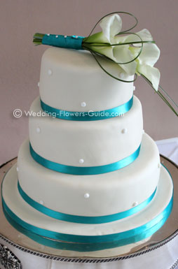 calla lily cake topper on a wedding cake